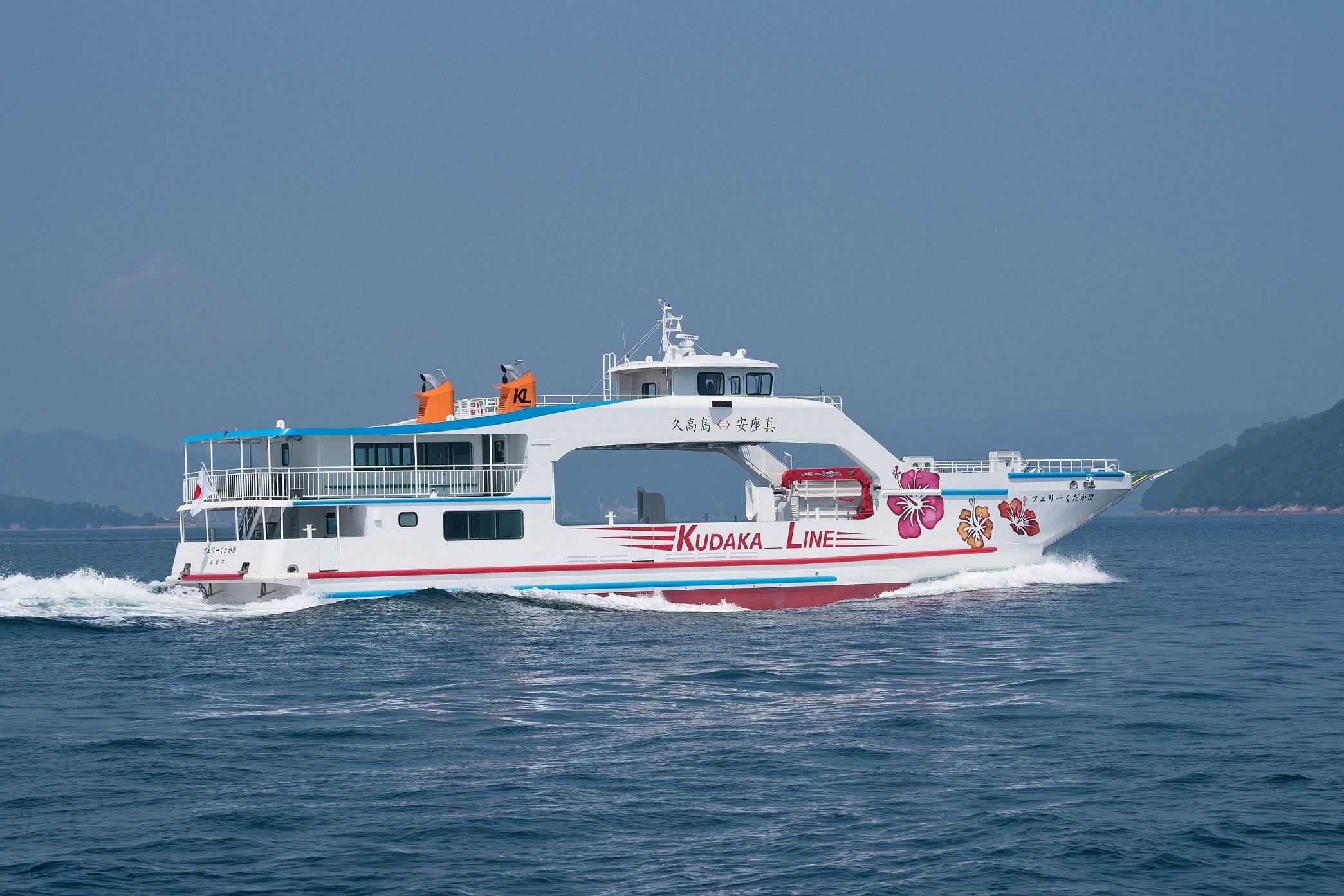"""""""Ferry KUDAKA III"""" is running among the waves"""